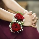 Bridesmaid with a rose corsage