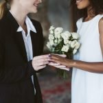 Close up caucasian woman in black suit and african american woma