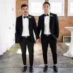 Two men in wedding attire suits